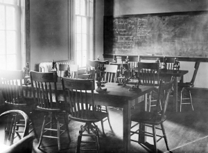 "It was remodeled for classes in 1918 due to a report in June of 1917 that described the New Dormitory and the Old Dormitory as ""public nuisances."" Photo of UK Special Collections."