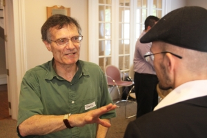 Terence Tunberg greets others at conference, in Latin, of course. Photo by Brian Manke